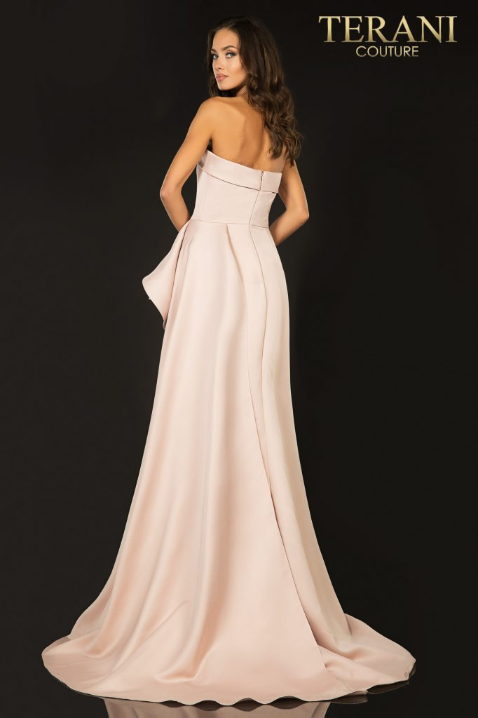 Blush colored Strapless A–line evening gown with a cascading peplum – Style number 2012P1288